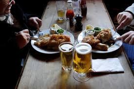 Customers dine at the King Edward VII pub in east London January 21, 2012. REUTERS/Eddie Keogh