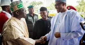 President Muhammadu Buhari shake hands with Asiwaju Bola Tinubu as Vice President Prof Osinbajo looks on during a symposium held at the International Conference Centre in Abuja to mark his 64th birthday ceremony.