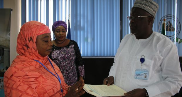 The Executive Director, Maritime Labour and Cabotage Services, Nigerian Maritime Administration and Safety Agency (NIMASA) Mr. Gambo Ahmed receiving a letter from the Executive Secretary, Kano State Scholarship Board, Professor Fatima Umar during a visit to the Agency to further the partnership under the Nigerian Seafarers Development Programme (NSDP) while the Head, Corporate Communications, Hajia Lami Tumaka looks on.